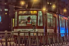 Tram in der Winternacht Stockfotografie