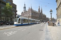 Tram driving in Amsterdam the Netherlands. Tram driving in Amsterdam historical center in the Netherlands Royalty Free Stock Photos