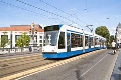 Tram driving in Amsterdam Netherlands. Tram driving in Amsterdam citycenter the Netherlands Royalty Free Stock Images