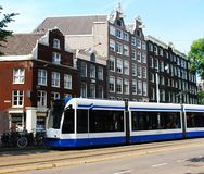 A tram driving in Amsterdam, the Netherlands stock images