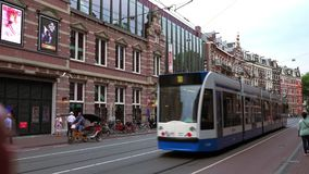 Tram driving through the city of Amsterdam  City of Amsterdam. Tram driving through the city of Amsterdam  Amsterdam Netherlands videoclip stock video