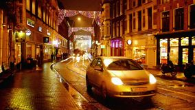 Tram driving in the city center from Amsterdam in the Netherlands. At night stock footage