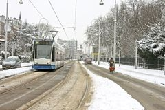 Tram driving in  snowy Amsterdam Netherlands Royalty Free Stock Image