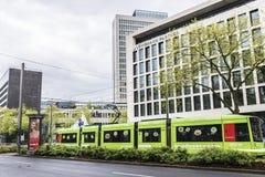 Tram in Dusseldorf, Germany. Dusseldorf, Germany - April 16, 2017: Tram with advertising in Dusseldorf, Germany on April 16, 2017 stock images