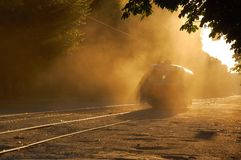 Tram. Dust. Sunset. Stock Photos