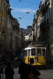 Tram Electrico 28 in a street of the Baixa neighbourhood, in the city of Lisbon. Lisbon, Portugal - February 17, 2018: The 28 Tram Electrico 28 in a street of stock image
