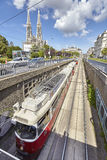 Tram entering tunnel in Vienna downtown. Royalty Free Stock Images