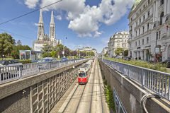 Tram entering tunnel in Vienna downtown. Royalty Free Stock Photos