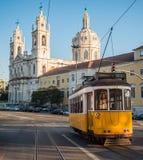 Tram in Estrela. Yellow tram passing by Estrela Basilica Royalty Free Stock Photo