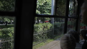 Tram goes past the park. in transport. transport passengers. HD stock video