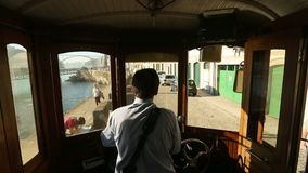 In the tram on heritage tourist line on the shores of Douro. PORTO, PORTUGAL - CIRCA NOV, 2015: In the tram on heritage tourist line on the shores of Douro stock video