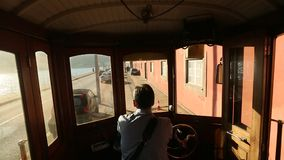 In the tram on heritage tourist line on the shores of the Douro. PORTO, PORTUGAL - NOV 7, 2015: In the tram on heritage tourist line on the shores of the Douro stock video