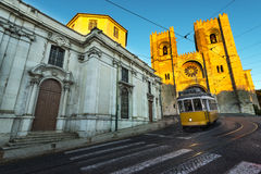 Tram in the hills of Lisbon. Tram in front of the Lisbon Cathedral at sunset stock photos