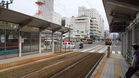 Tram in Hiroshima. Tram leaving the station in Hiroshima stock footage