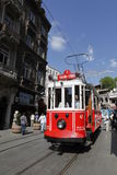 Tram in Istanbul,Turkey. A man ride a tram on Istiklal Street,on May 25,2011.Istiklal street is a busy pedestrian shopping street leading to the Taksim Square in Stock Photo
