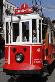 Tram in Istanbul,Turkey. A man ride a tram on Istiklal Street,on May 25,2011.Istiklal street is a busy pedestrian shopping street leading to the Taksim Square in Stock Images