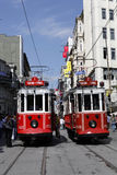 Tram in Istanbul,Turkey. Two trams side by side on Istiklal Street,on May 25,2011.Istiklal street is a busy pedestrian shopping street leading to the Taksim Stock Images