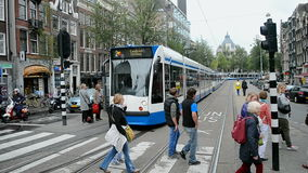 Tram line stop, Red Care manifestation at the Damrak square in Amsterdam, Netherlands, stock video footage