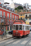 Tram in Lisbon, Portugal. LISBON, PORTUGAL - MARCH 22, 2013: Vintage, orange streetcar or tram, a mode of public transportation on the hills of Alfama in Lisbon Royalty Free Stock Photo