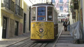 Tram in Lisbon, Portugal. A traditional tram in Lisbon, Portugal stock footage