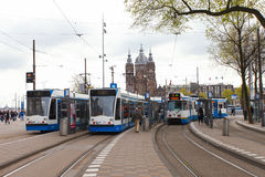 Tram (Local light rail transportation) heading to Amsterdam central station Stock Photos