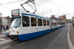 Tram (Local light rail transportation) heading to Amsterdam central station Stock Images
