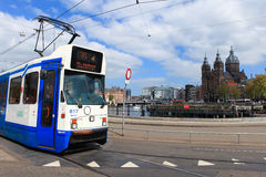 Tram (Local light rail transportation) heading to Amsterdam central station Royalty Free Stock Image