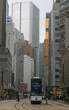 tram makes it way through the hi rise offices of Central District of Hong Kong Royalty Free Stock Image