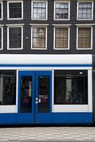 Tram and mansion, Amsterdam Royalty Free Stock Image