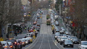 Tram in Melbourne. Melbourne Street with trams and cars Stock Images