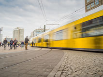 Tram in motion at Alexander Platz in Berlin, Germany. With blured people. Hectic everyday life at Alexanderplatz Royalty Free Stock Photography
