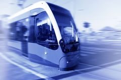 Tram in motion blur on the street Royalty Free Stock Photo