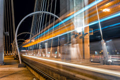 Tram in motion blur on a suspended bridge Stock Image