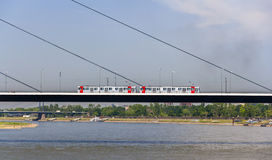 Tram mouving on Oberkasseler bridge in Dusseldorf Royalty Free Stock Image