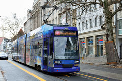 Tram moves through central part of Leipzig. Royalty Free Stock Photography