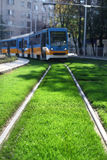 Tram moves over grass Royalty Free Stock Photography