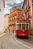 Tram on narrow street of Alfama, Lisbon Stock Photos