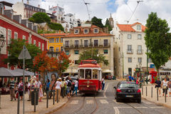 Tram on narrow street of Alfama, Lisbon Royalty Free Stock Photo