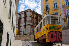 Tram on narrow street of Alfama, Lisbon Stock Photo