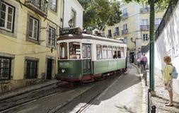 Tram in narrow street of Lisbon. royalty free stock photography