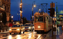 Tram no. 49. BUDAPEST / HUNGARY - SEPTEMBER 26: tram number 49 running at dusk, with unidentified people and cars around on September 26, 2015 in Budapest Royalty Free Stock Image