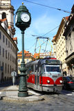 Tram and old clock in Prague Royalty Free Stock Photo