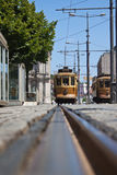 Tram in Oporto, Portugal. From the ground perspective image of one of the tram vehicles that are part of the public transportation system in the city of Oporto Stock Photos