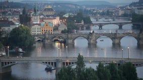Tram passes on the bridge through Vltava in Prague stock video