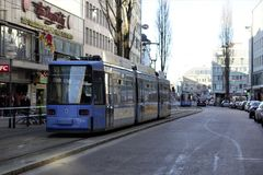 A blue tram in downtown Munich on a bright winter`s morning. A tram passesthrough Munich city centre in January as workers` unions threaten strikes across the Royalty Free Stock Photo