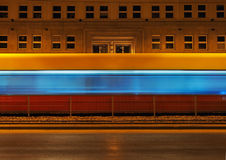 Tram passing the background night scenery building Royalty Free Stock Images