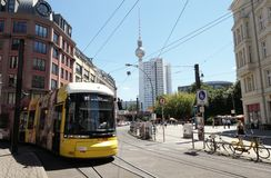 Tram passing by the Hackescher Markt place in Berlin mitte dirstrict (Germany). People walking along the streets. royalty free stock photos
