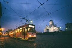 Tram passing Helsinki Senate Square during sunset with Helsinki. Cathedral in the background at Finland Stock Images