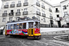 Tram 28 passing through Lisbon streets Royalty Free Stock Photography