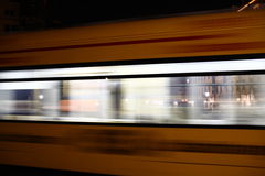 Tram passing by at night Royalty Free Stock Photos